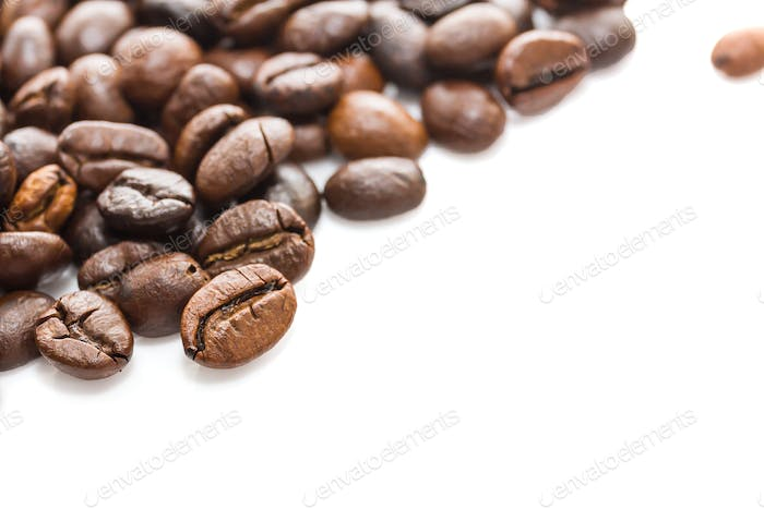 Roasted coffee beans on white