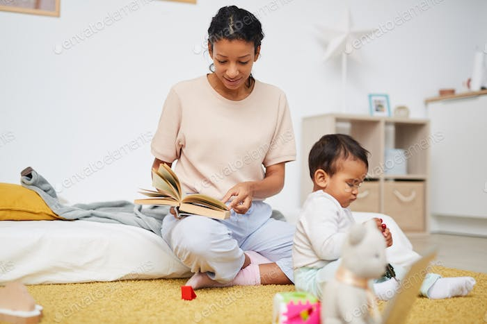 Mother reading a tale to her child