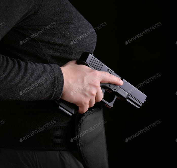 Hand with a gun