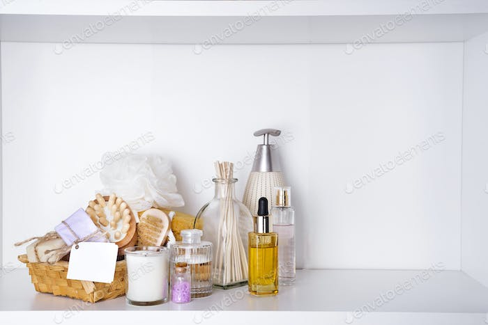 Various spa and beauty threatment products on white shelf