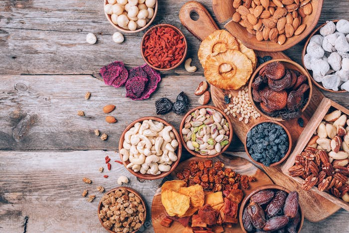 Assortment of nuts and dried fruits - brazil nuts, cashew, pecan, almonds, macadamia, pine nuts