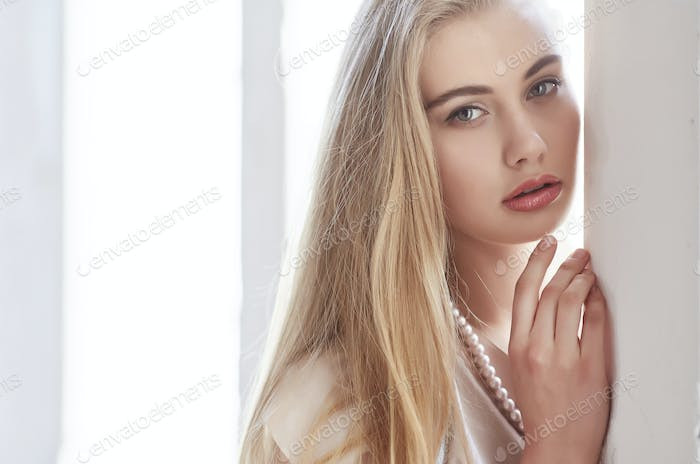 Awesome young woman with long blond hair.