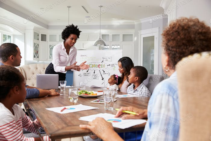 Businesswoman presents meeting to a family in their kitchen
