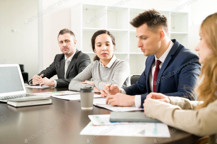 Row of Business People in Meeting