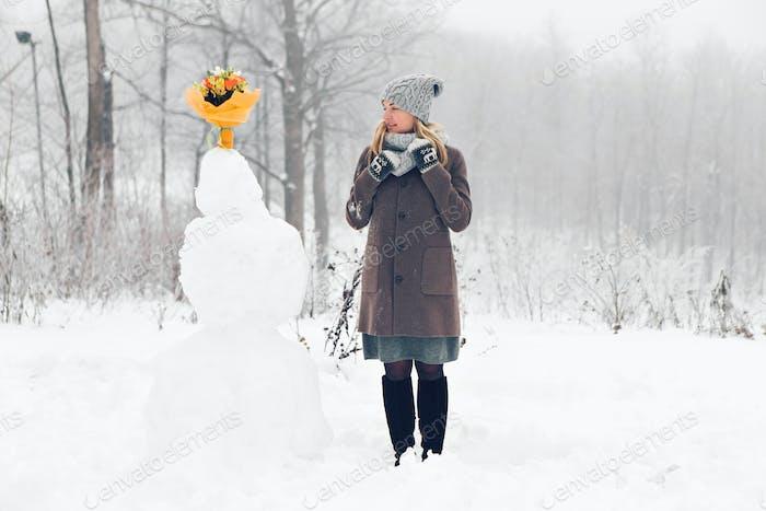 Woman make snowman