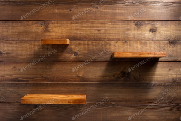 shelf on wooden wall background