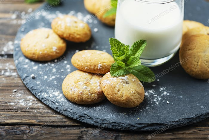 Homemeade cookies with milk on the wooden table