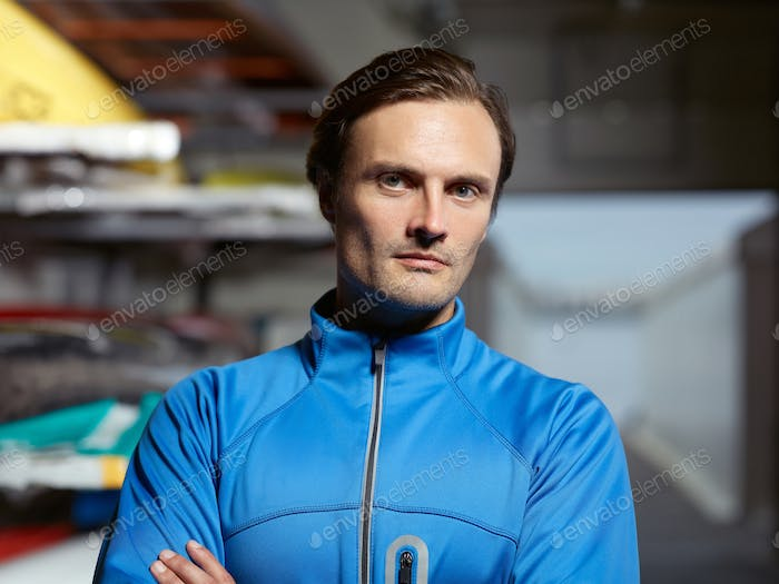 Portrait of confident Caucasian sportsman in blue swimming jacket