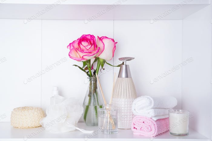 Thumbnail for Spa settings with roses. Fresh roses and rose petals and various items used in spa treatments for