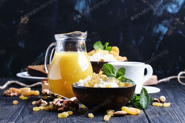 Breakfast with cottage cheese, dried fruits, nuts, juice, coffee and toast