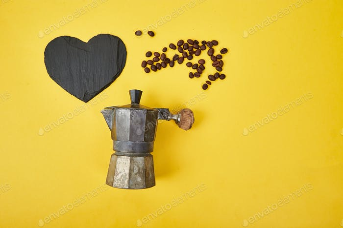 Flat lay of Coffee maker and coffee beans on yellow background.