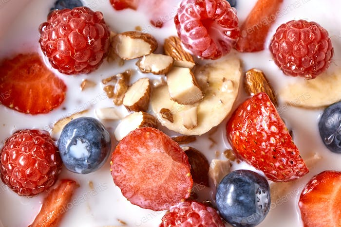 Close up of natural fresh ingredients with healthy breakfast - strawberry, blueberry, chopped