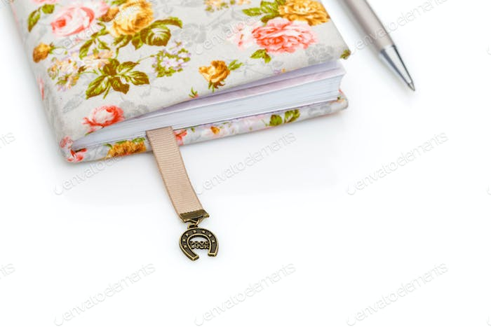 Handmade notebook fragment with horseshoe bookmark