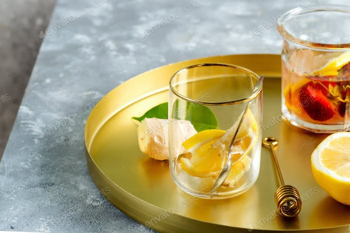 Close up of a healthy ingredients for Ginger, lemon and honey tea on a copper tray