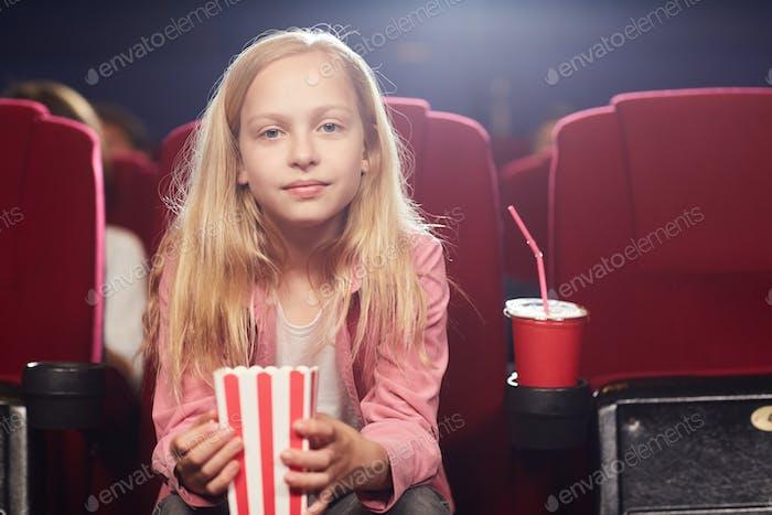 Cute Teenage Girl in Cinema