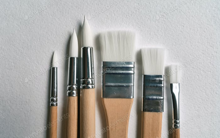 Brushes on a watercolor paper