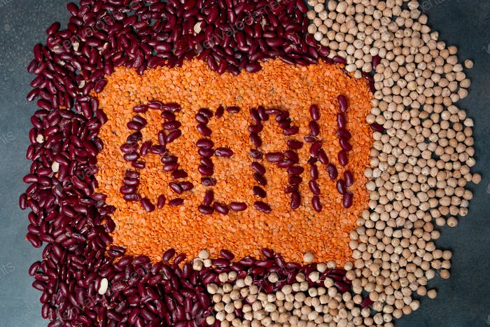 "Group of beans, lentils and chick-pea  on black background. beans assortment. sign "" beans"""