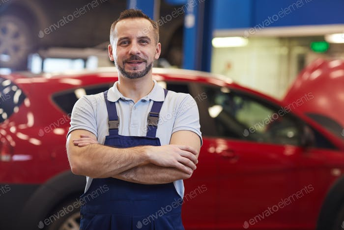 Mechanic Posing with Red Car