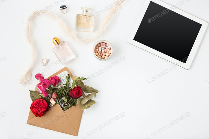 Top view of white office female workspace with laptop