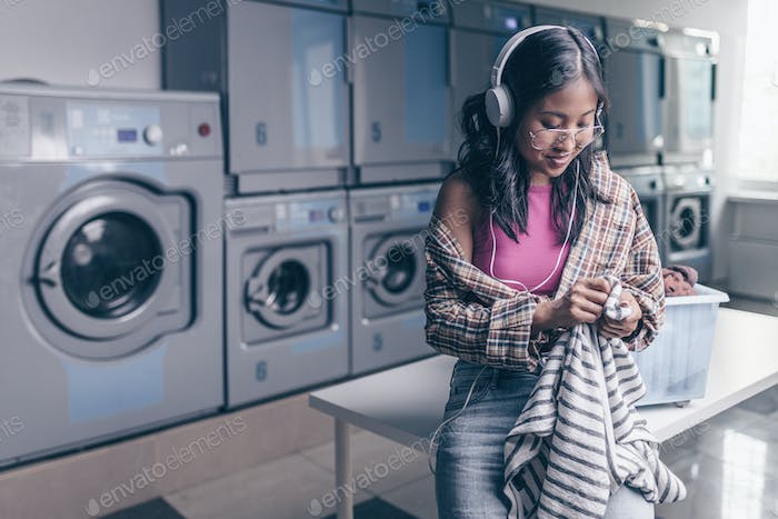 Young girl with laundry