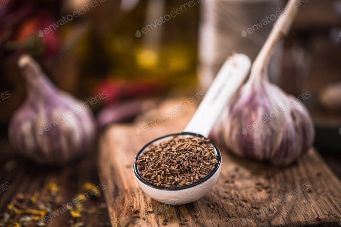 Whole cumin seeds on spoon,spices and herbs concept