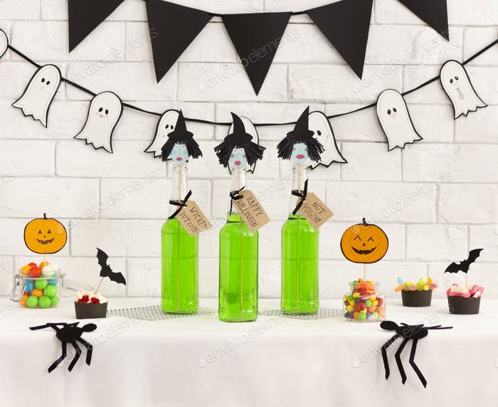 Halloween cute witches as green cocktail and spiders with cakes