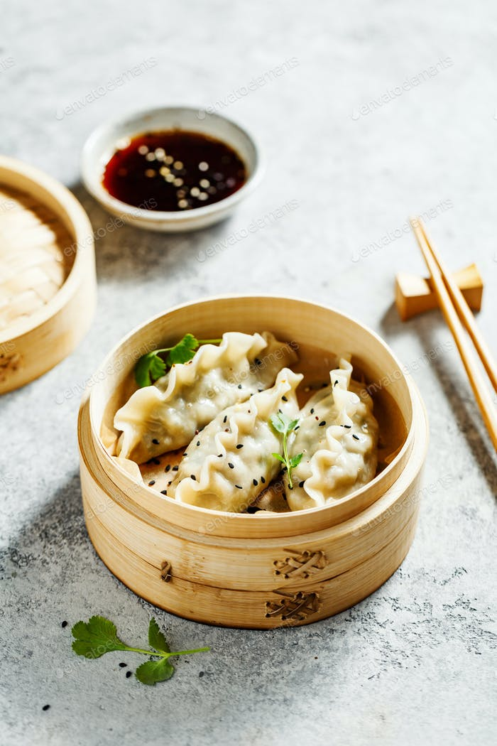 Delicious dumplings in bamboo steamer