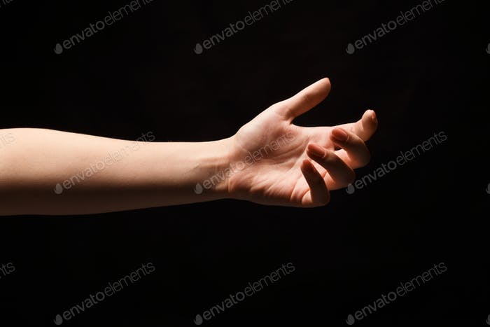 Outstretched female hand offering or asking for help