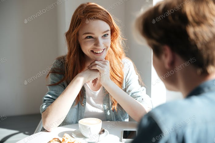 Young student woman listening her friend