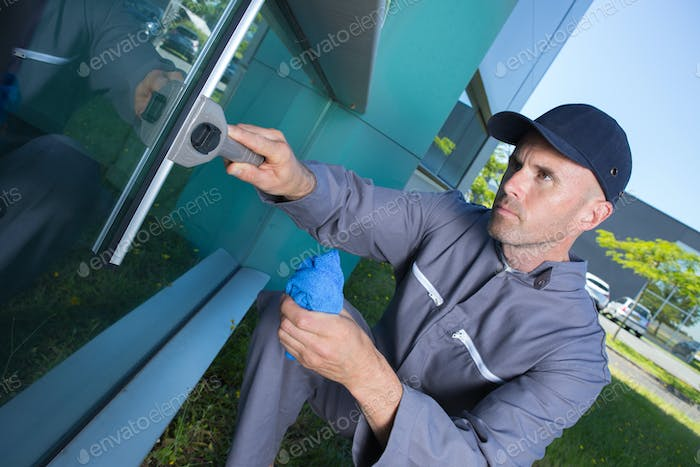 Thumbnail for man cleaning windows