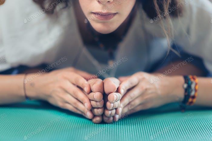 Yoga Frau im Yoga Studio