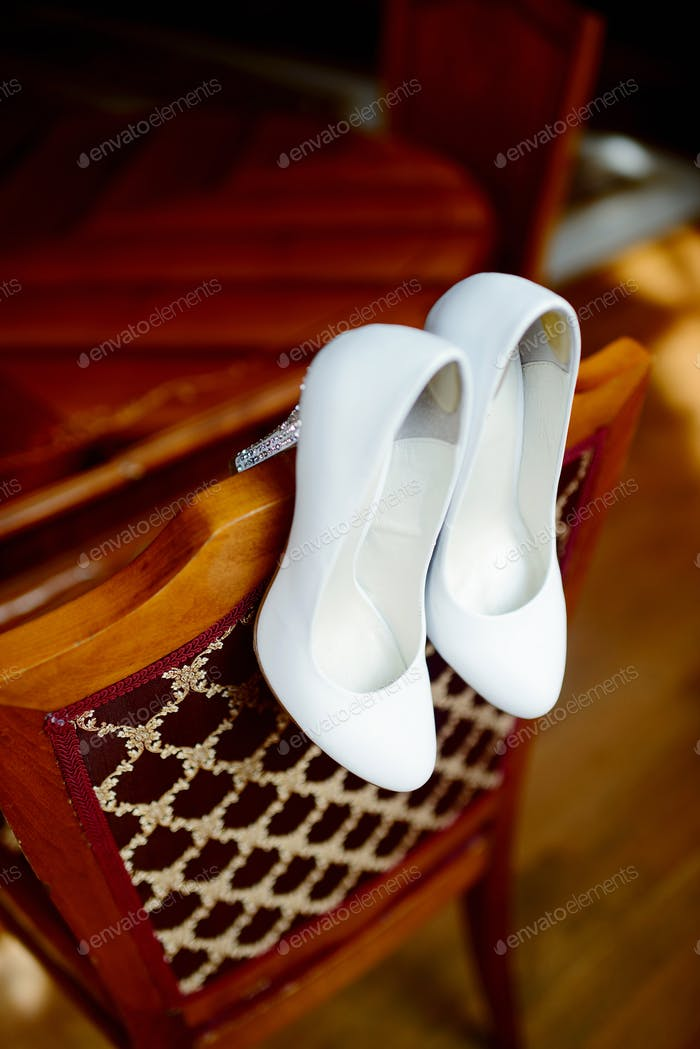 Beautiful colorful wedding shoes for bride indoors