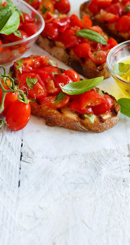 Homemade Italian Bruschetta Appetizer with cherry tomatoes and basil