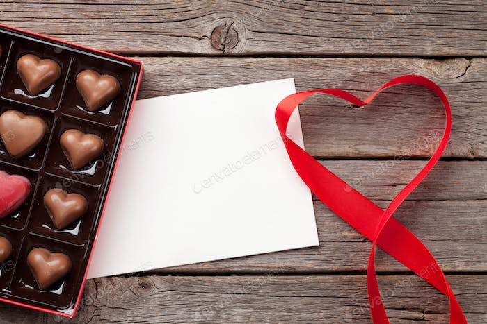 Valentines day greeting card with heart shaped chocolate