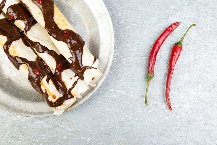 Mexican chicken enchiladas with chili chocolate salsa