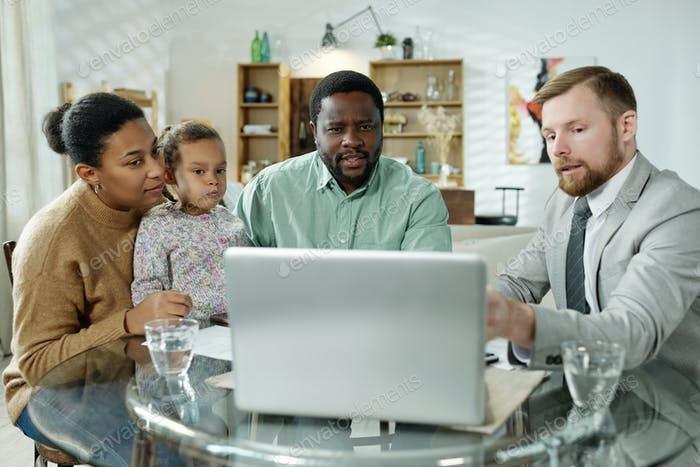 Consultant showing presentation to ethnic family