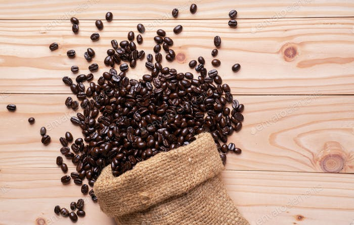 Coffee beans spilled out from linen sack