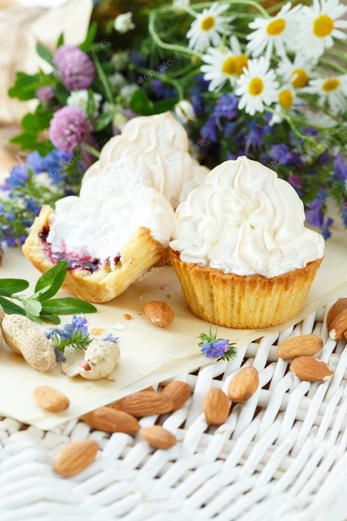 Cupcakes with blueberries and white cream