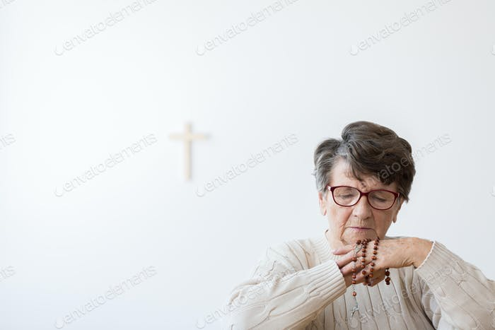 Grandma praying alone