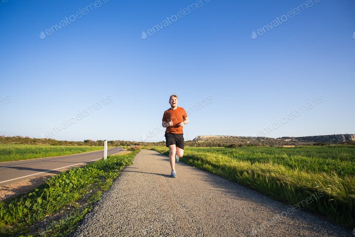 fitness runner sport athlete in sprint at great speed in beautiful landscape
