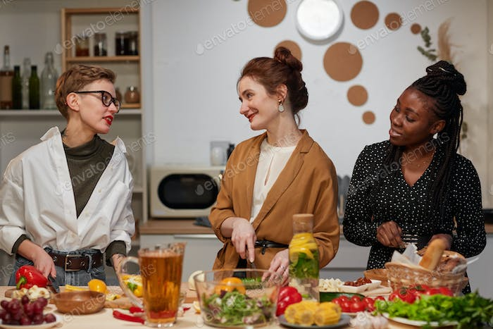 Group of women cooking together