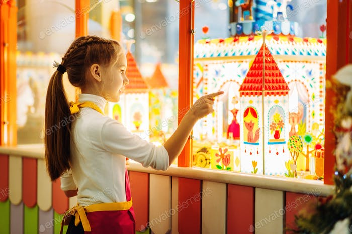 Girl watching on showcase with caramel buildings