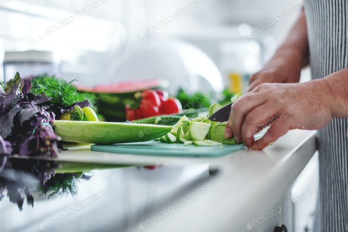 Woman cooking vegetables in the kitchen