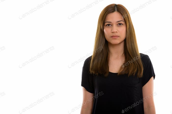 Studio shot of young beautiful woman isolated against white background