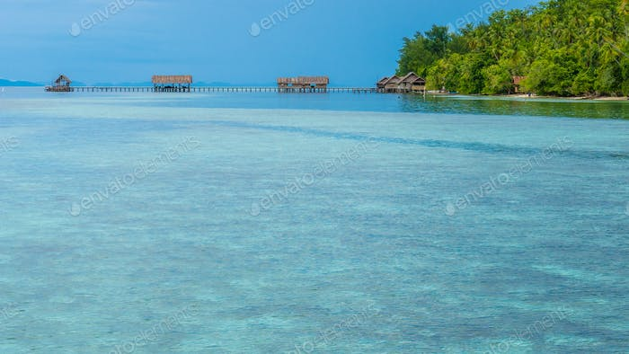 Bay with Underwater Corals in Front of Diving Station and Guesthouses on Kri Island, Raja Ampat