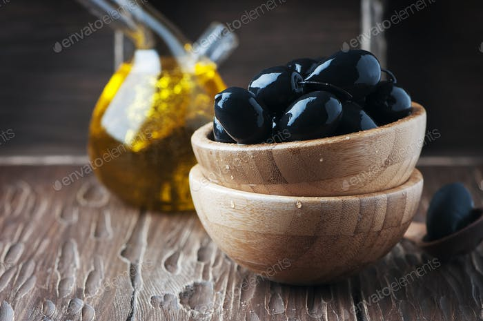 Black olive on the wooden table