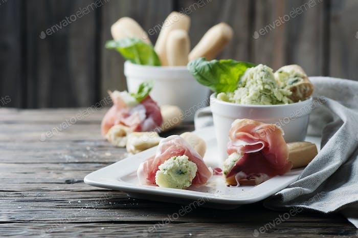 Italian grissini with cream cheese and prosciutto