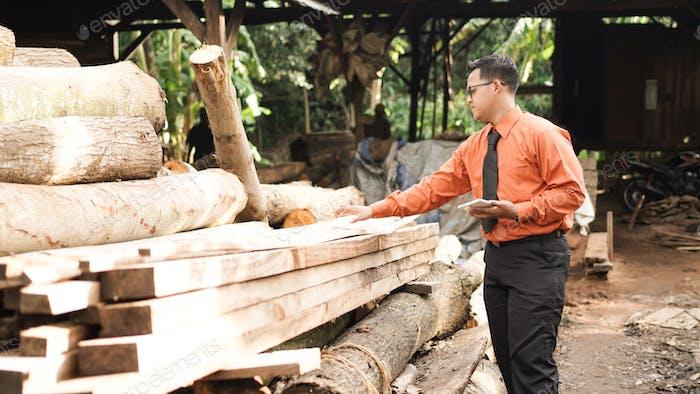 asian businessman wood craft
