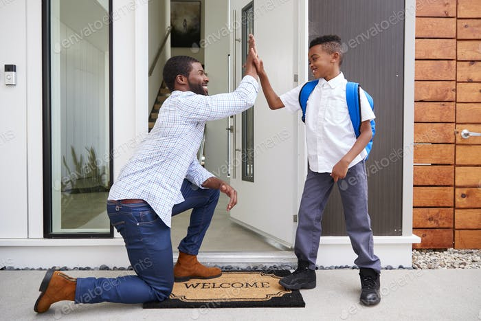 Father Giving Son High Five As He Leaves For School