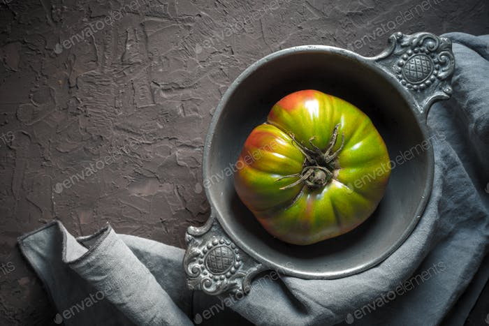 Thumbnail for Colorful tomato in a tin bowl on a gray napkin